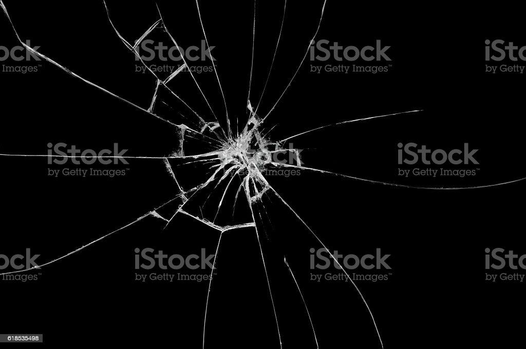 Broken glass on black background stock photo