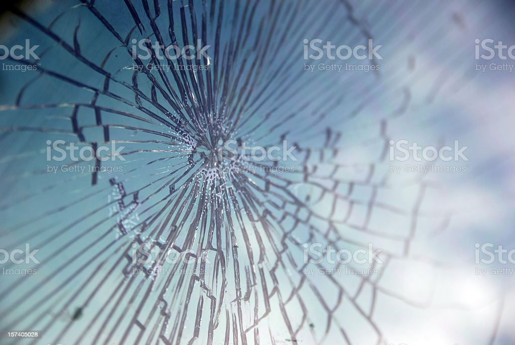 Broken glass reflecting sky royalty-free stock photo