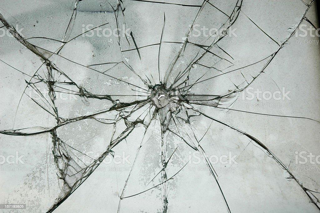 Broken Glass Window Bullet Shooting impact hole cracks royalty-free stock photo