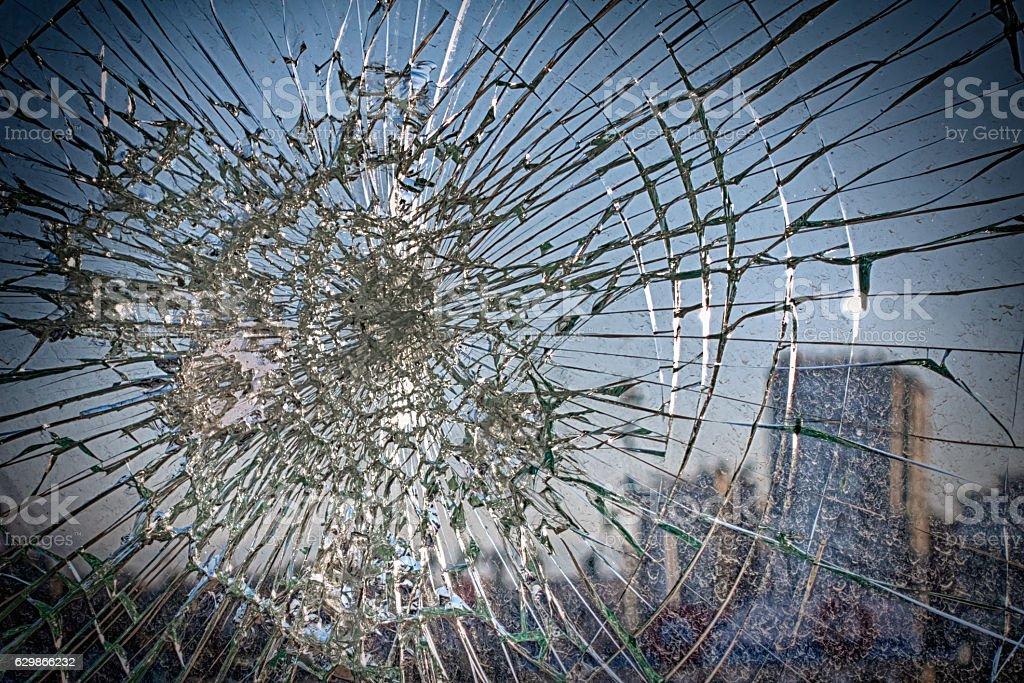 Broken glass with terrorist incidents stock photo