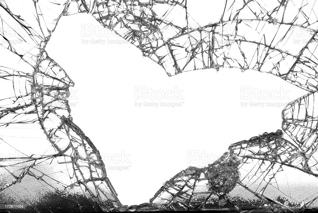 Broken glass with the shape of a heart fallen out stock photo