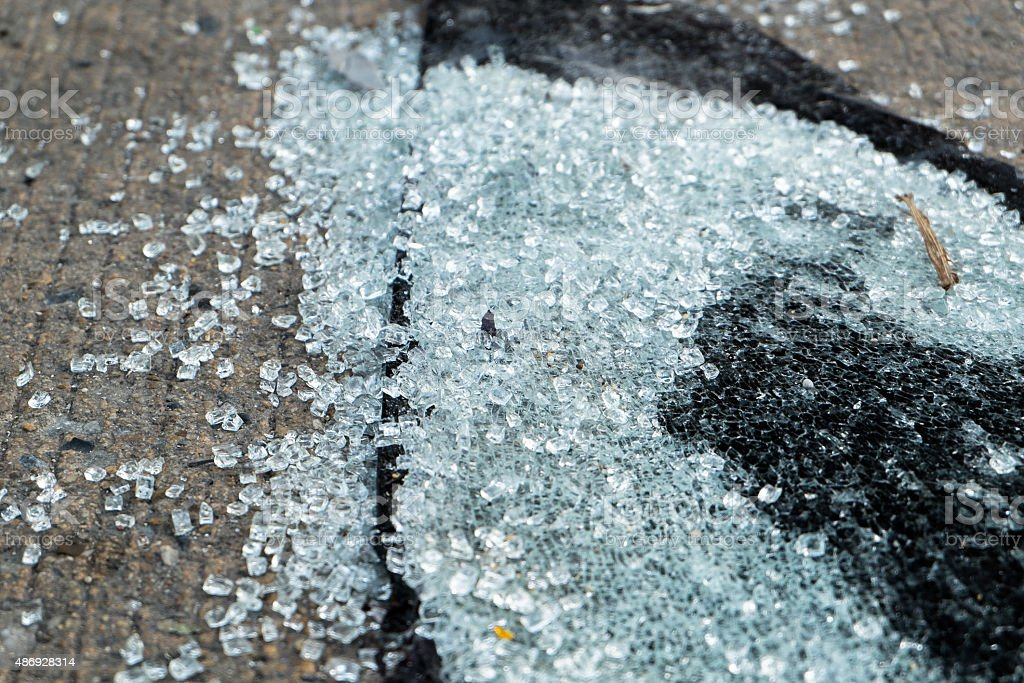 Broken Glass,A safety glass shattered in many pieces stock photo