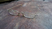 Broken glasses on scratched rusty metal surface