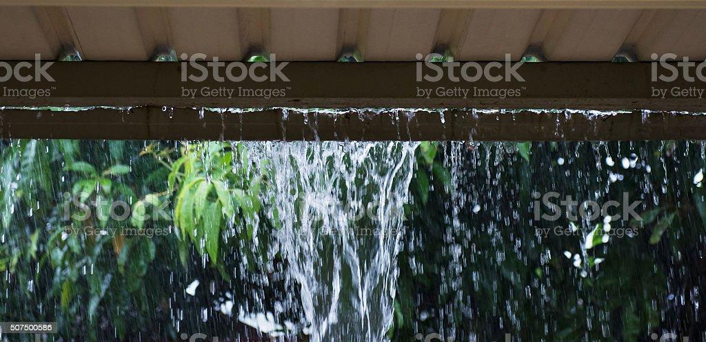Broken Gutter with rain pouring through stock photo