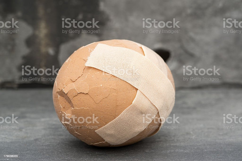 Broken healthcare concept image of plaster on egg stock photo