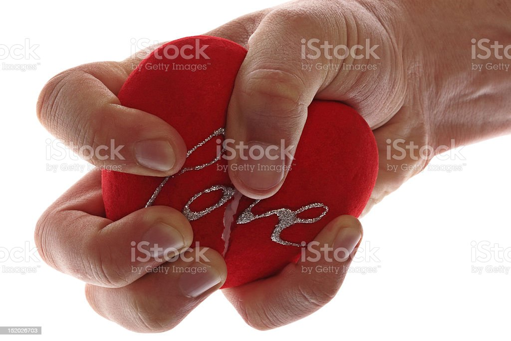 Broken heart in hand. royalty-free stock photo