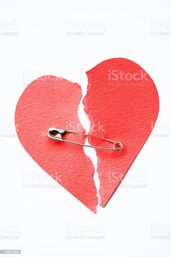 Broken heart joined with safety pin royalty-free stock photo