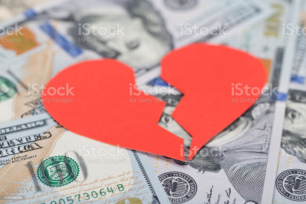 Broken Heart On Dollar Bills stock photo