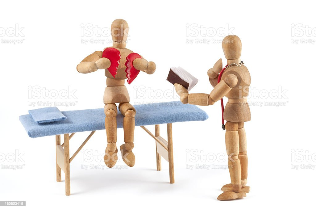 broken heart - wooden mannequin at doctor royalty-free stock photo