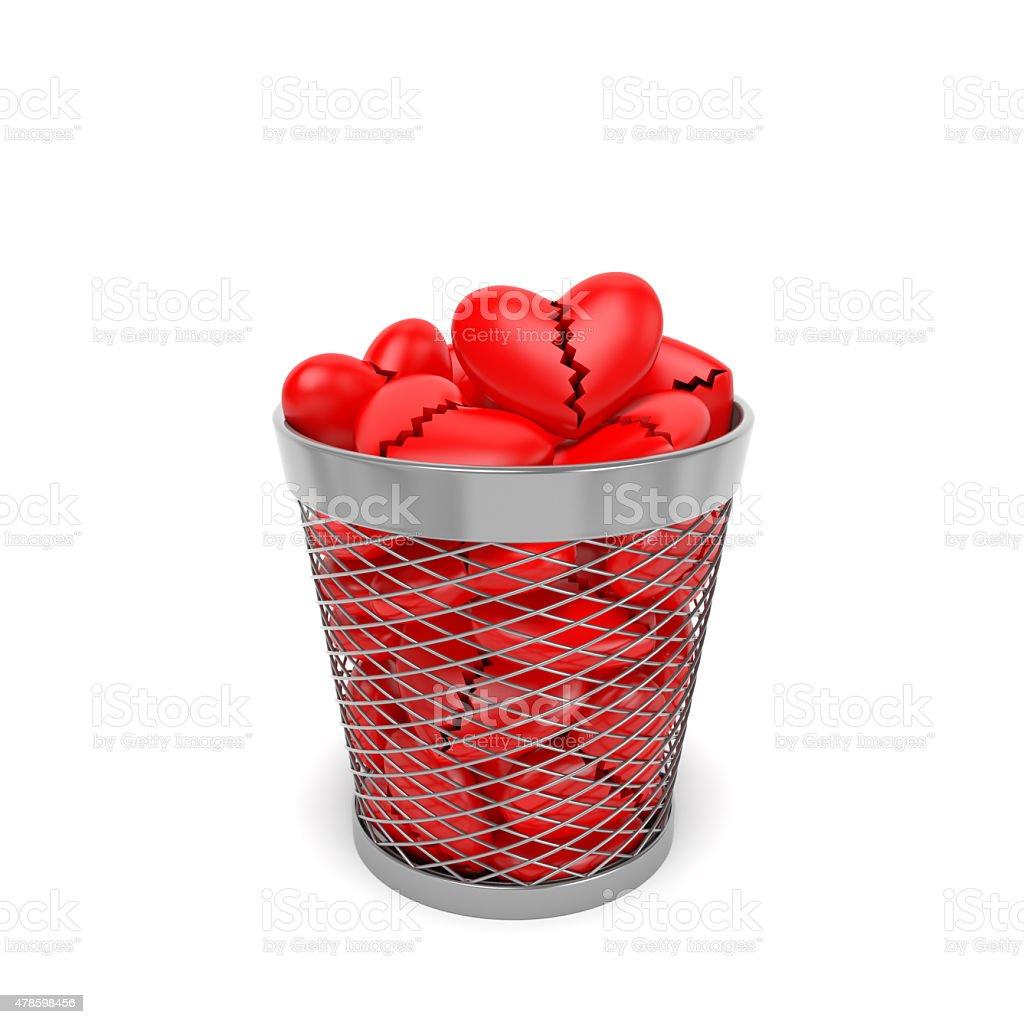 Broken hearts in trash bin stock photo