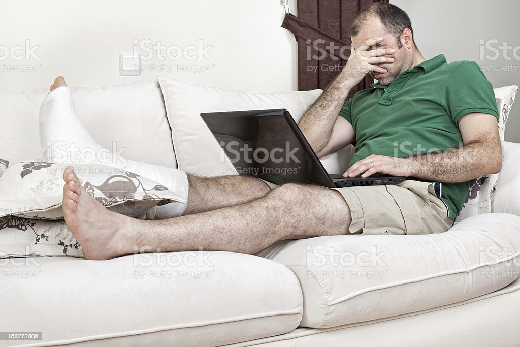 Broken Leg and Working in Home Office stock photo