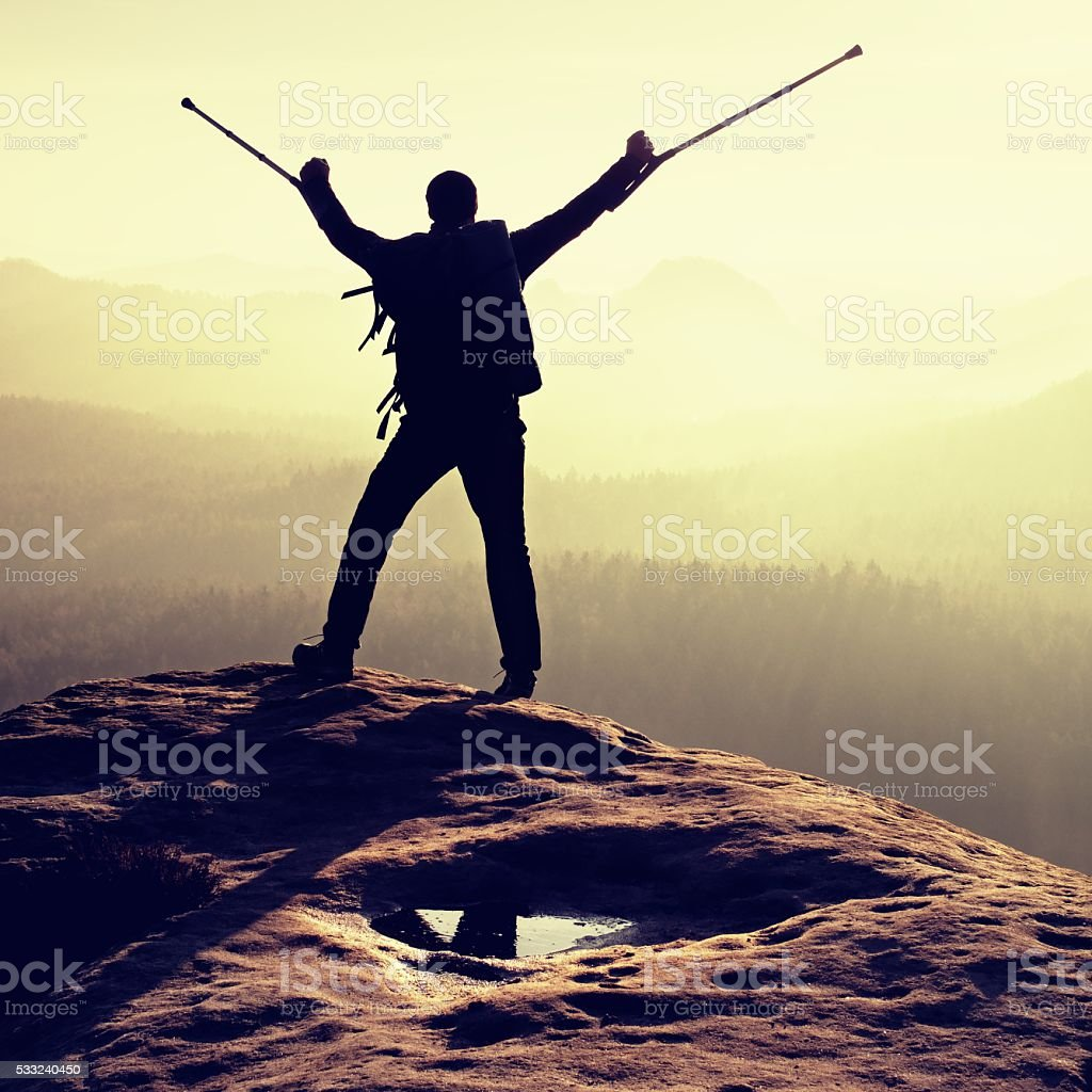 Broken leg hiker, immobilizer and medicine pole above head stock photo