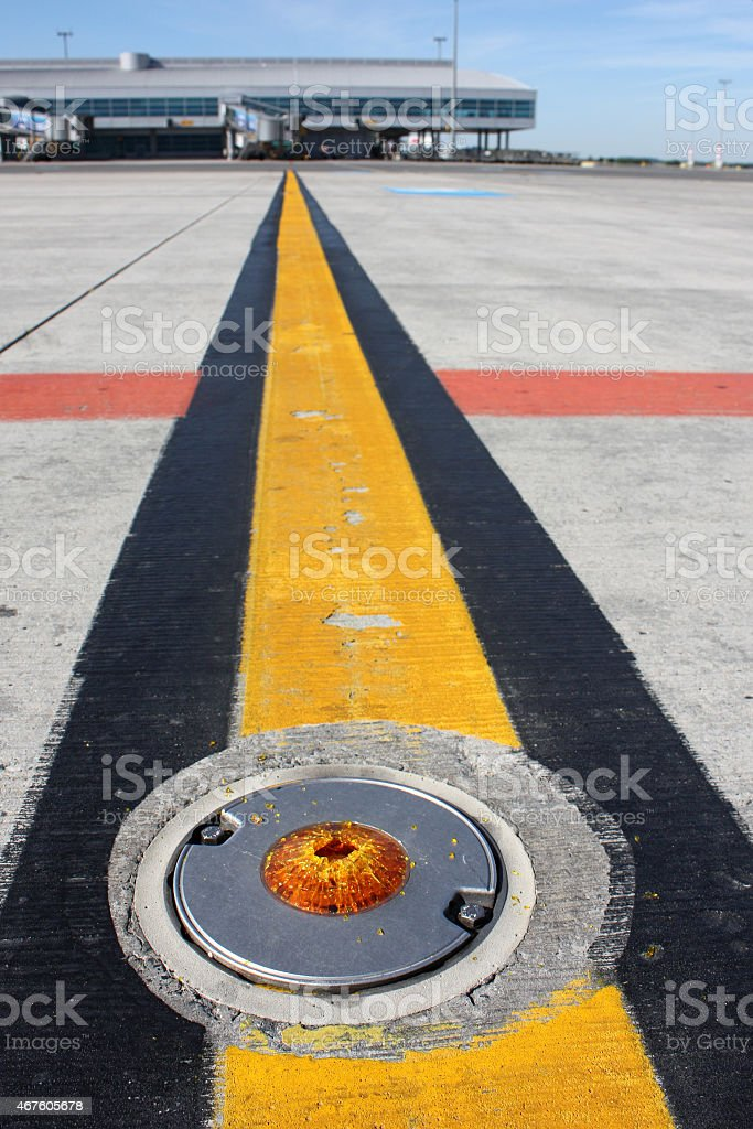 Broken light on taxiway stock photo