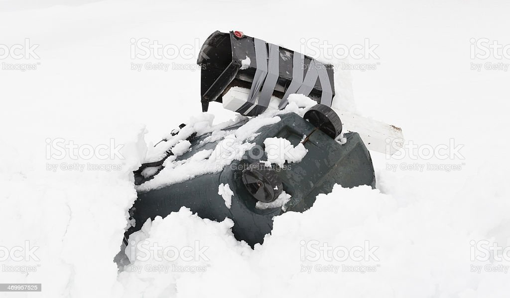 Broken Mailbox and Trash Can in a Snow Pile royalty-free stock photo