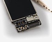 Broken Microchips Board and Mobile Phone on White background