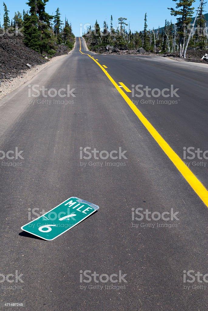 Broken mileage marker sign on highway near McKenzie Pass Oregon royalty-free stock photo