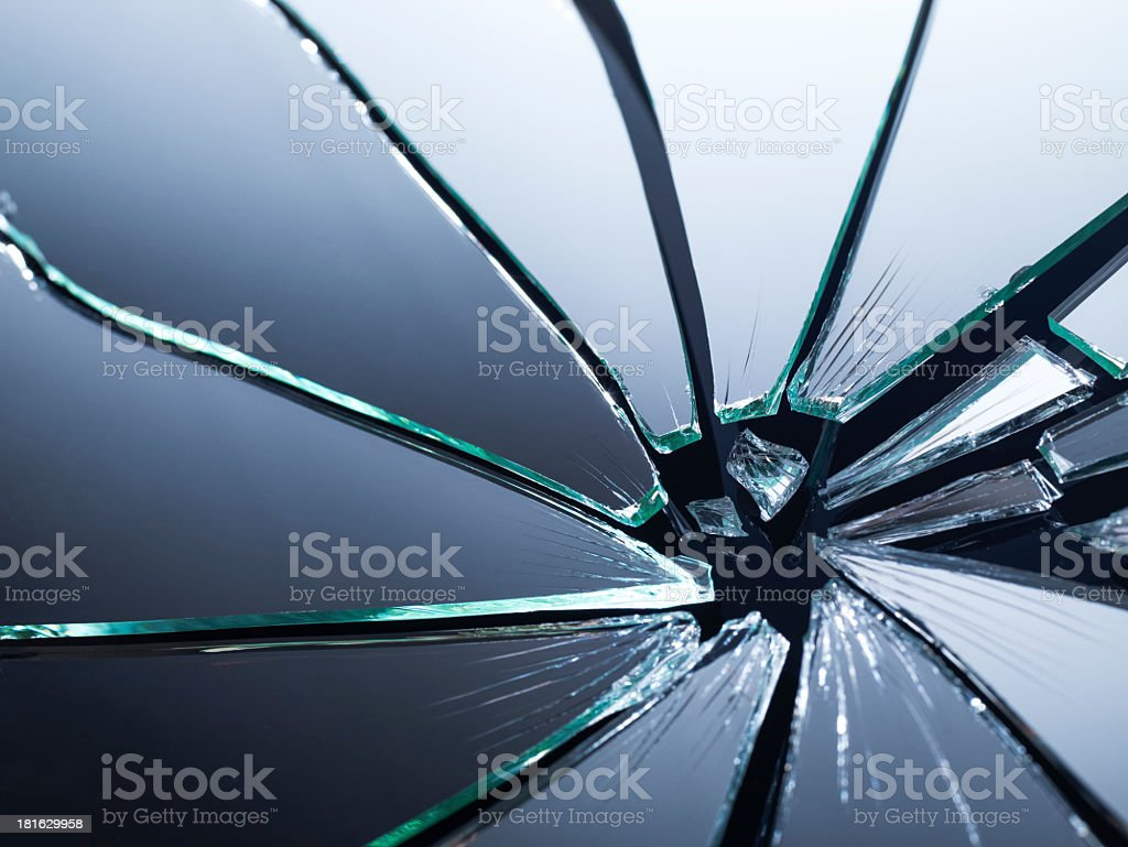 Broken mirror shattered into pieces stock photo
