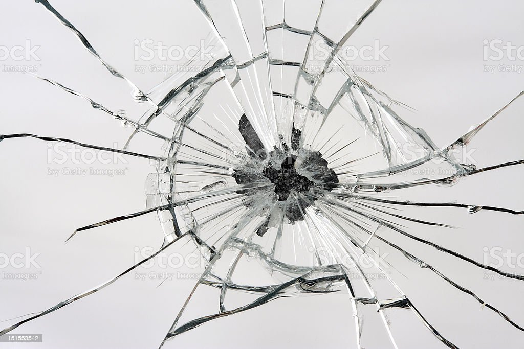 Broken mirror with central hole from impact stock photo