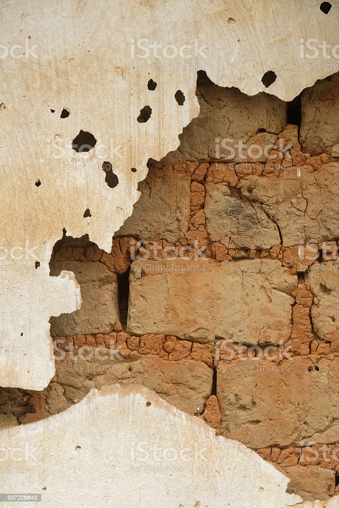 Broken mud wall background stock photo