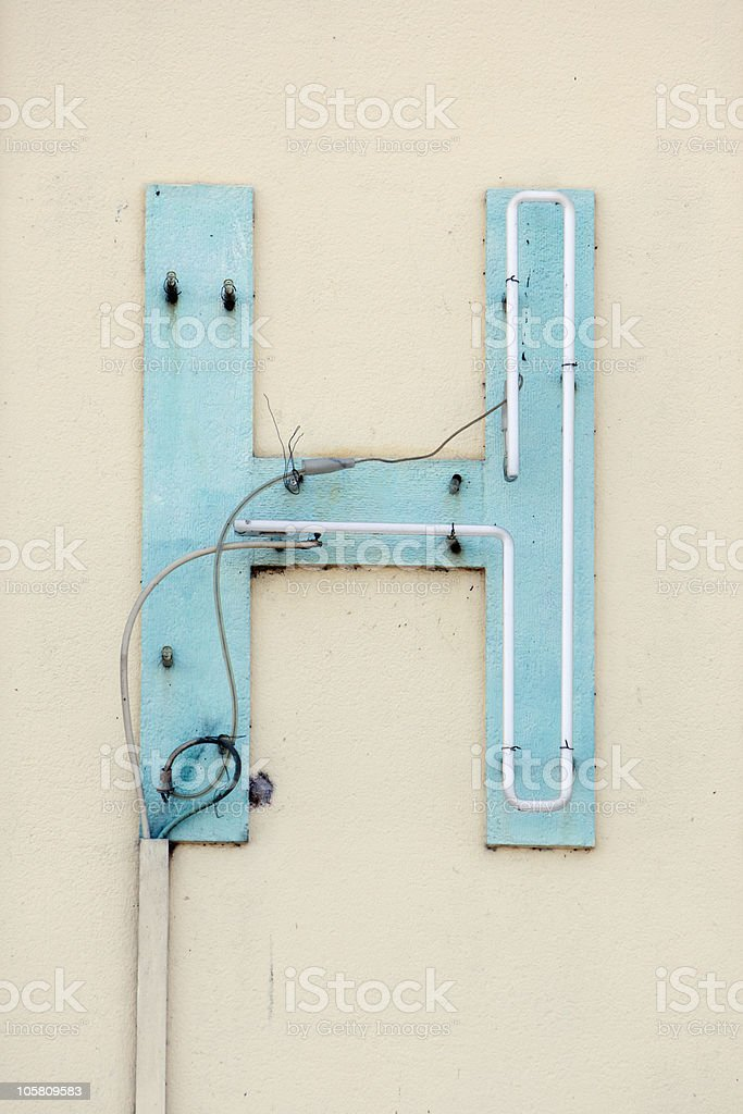 broken neon sign letter H royalty-free stock photo