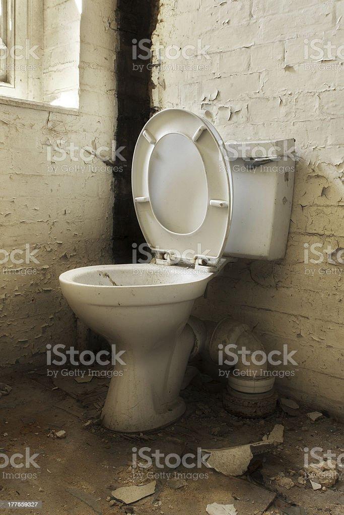 Broken old abandoned toilet stock photo