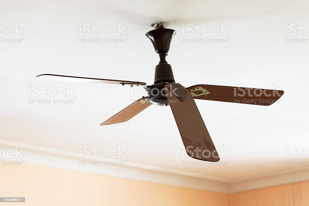 Broken old celling fan in abandoned building hanging from ceiling stock photo
