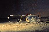 Broken Old-fashioned Male Glasses