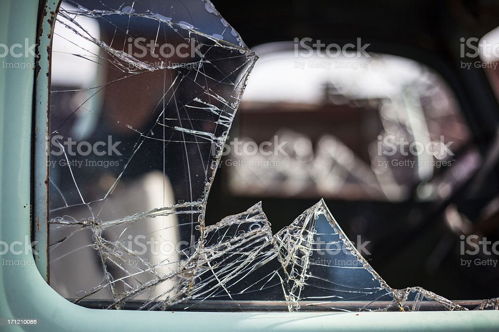 Broken Out and Shattered Window from an Antique Blue Car stock photo