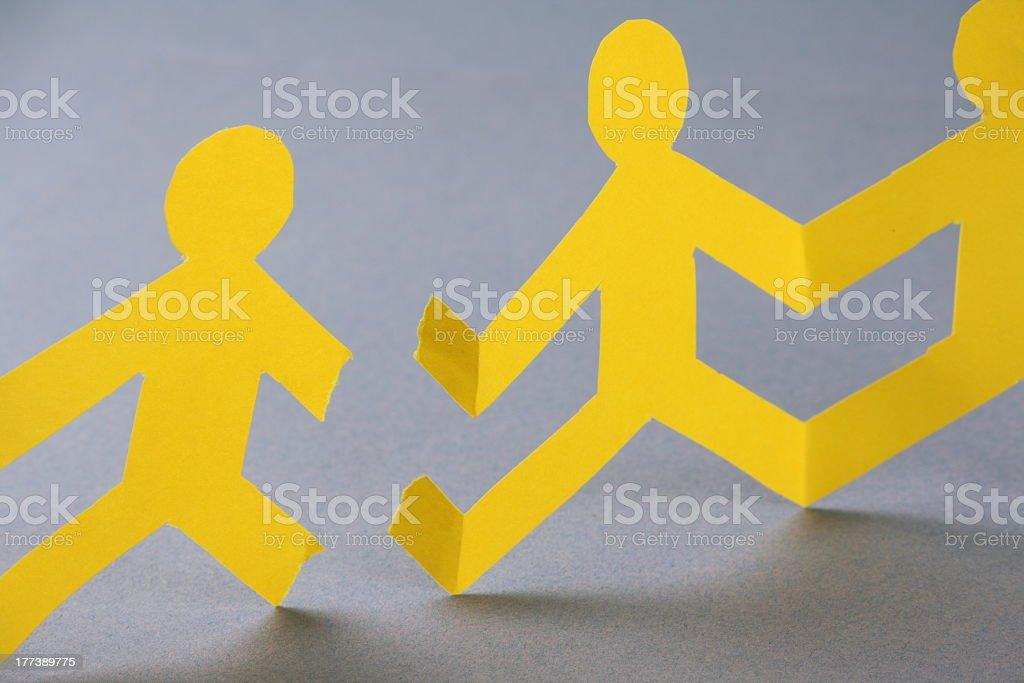 Broken Paper People Chain stock photo