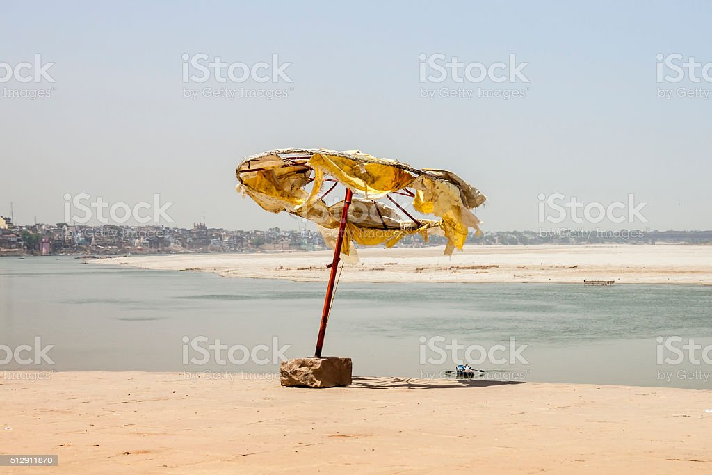 Broken parasol at Ganga River. Varanasi. India. stock photo