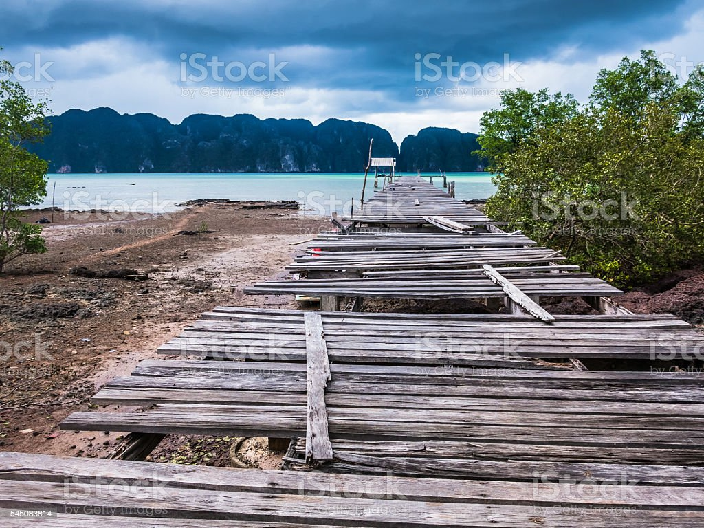 Broken Pier on Tropical Castaway Island stock photo