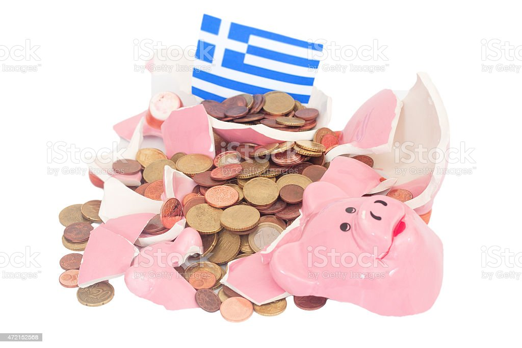 Broken piggy bank with coins and Greek flag to show crisis  stock photo