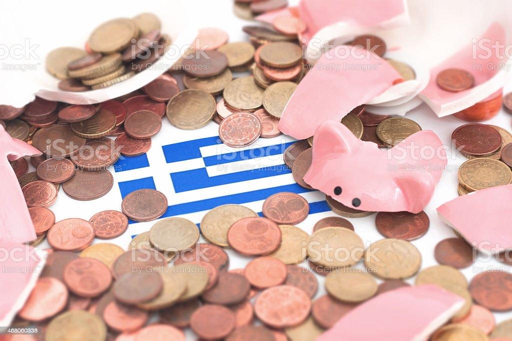 Broken Piggybank with a flag of greece stock photo