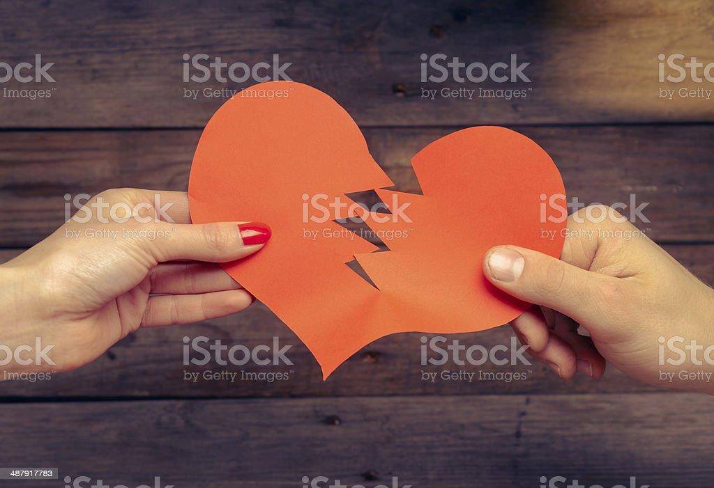 Broken red paper heart stock photo
