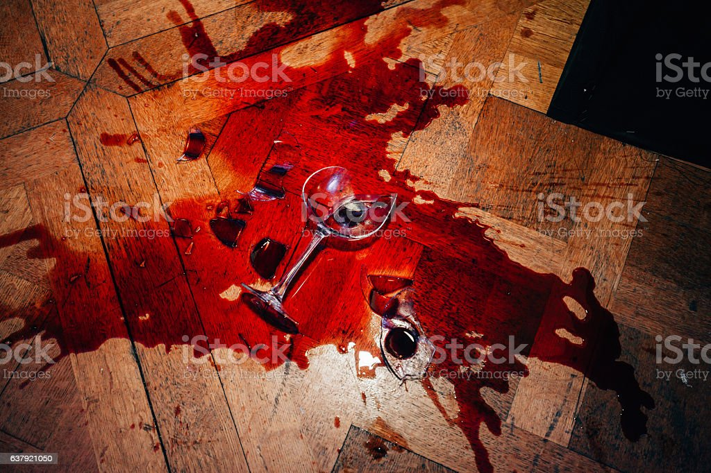 Broken red wine glass stock photo