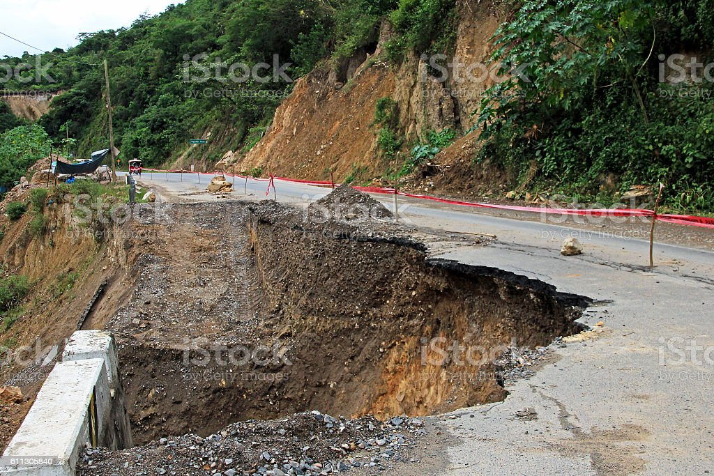 Broken road in the peruvian mountains stock photo