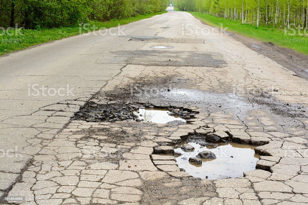 Broken road in the woods stock photo