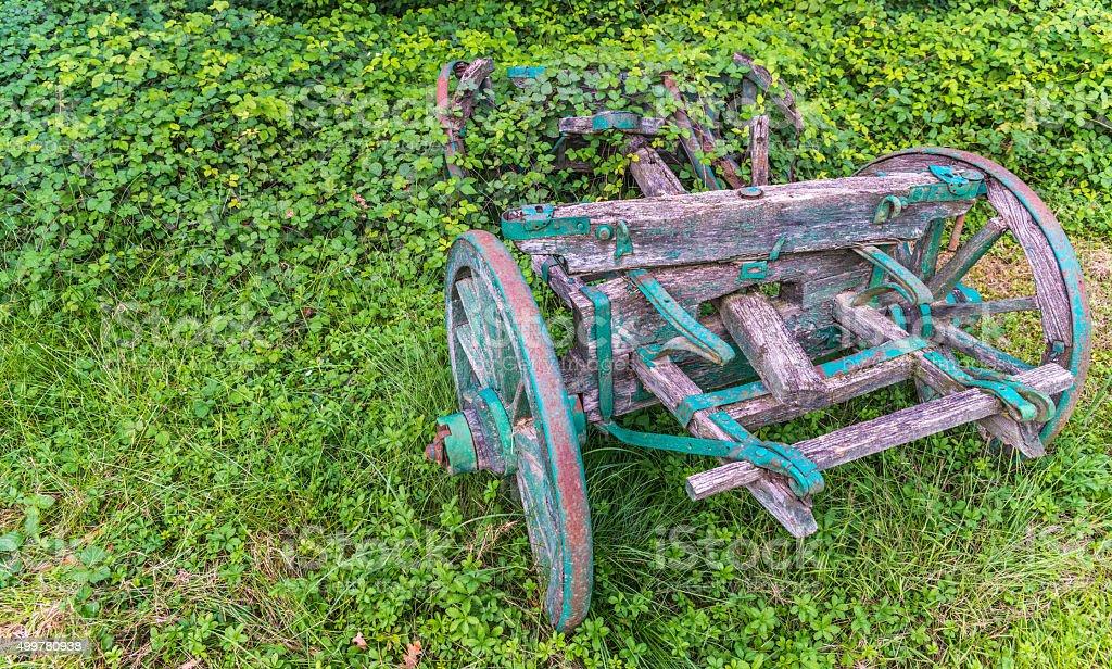 Broken rusty wheelbarrow stock photo