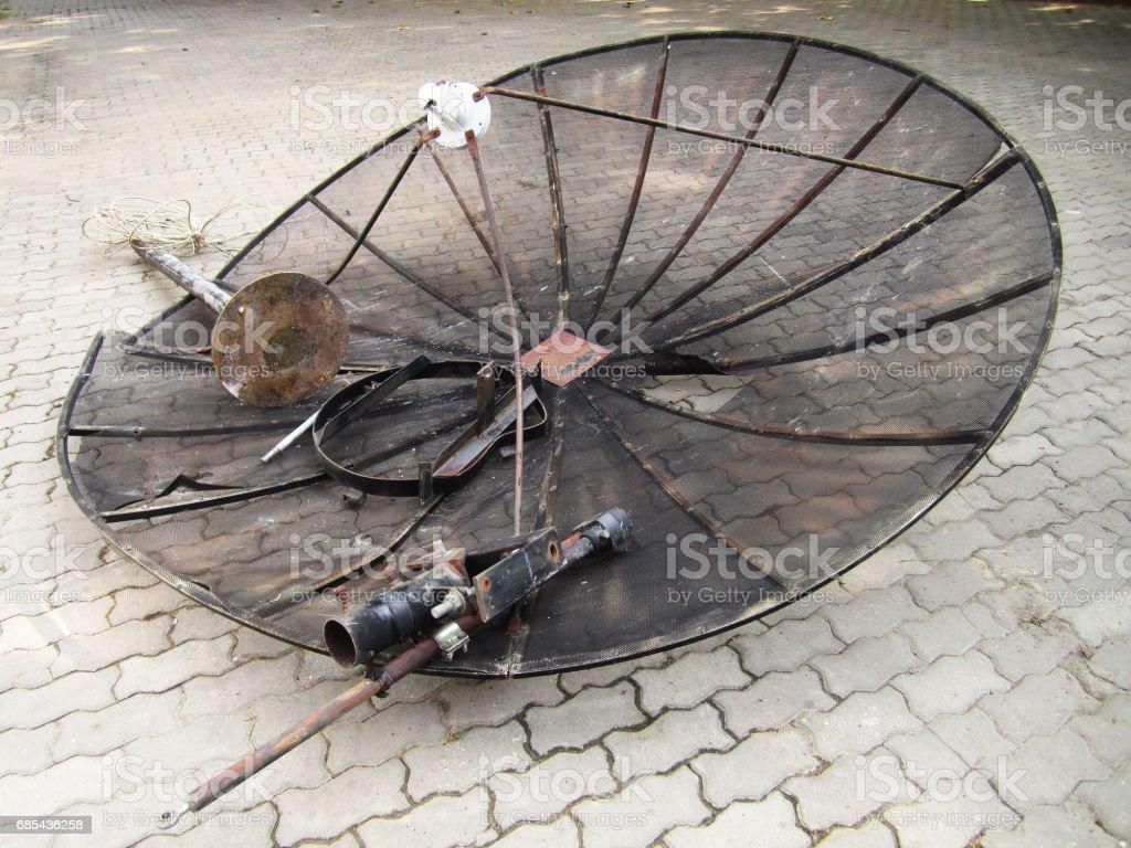 broken Satellite dish on the floor stock photo