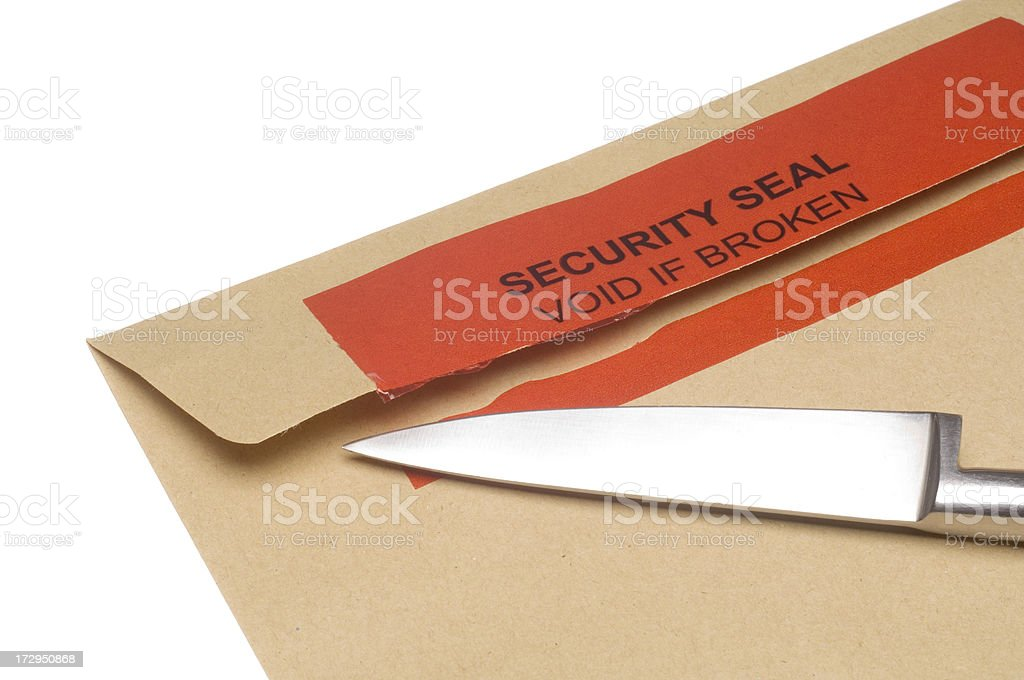 Broken security seal with knife stock photo