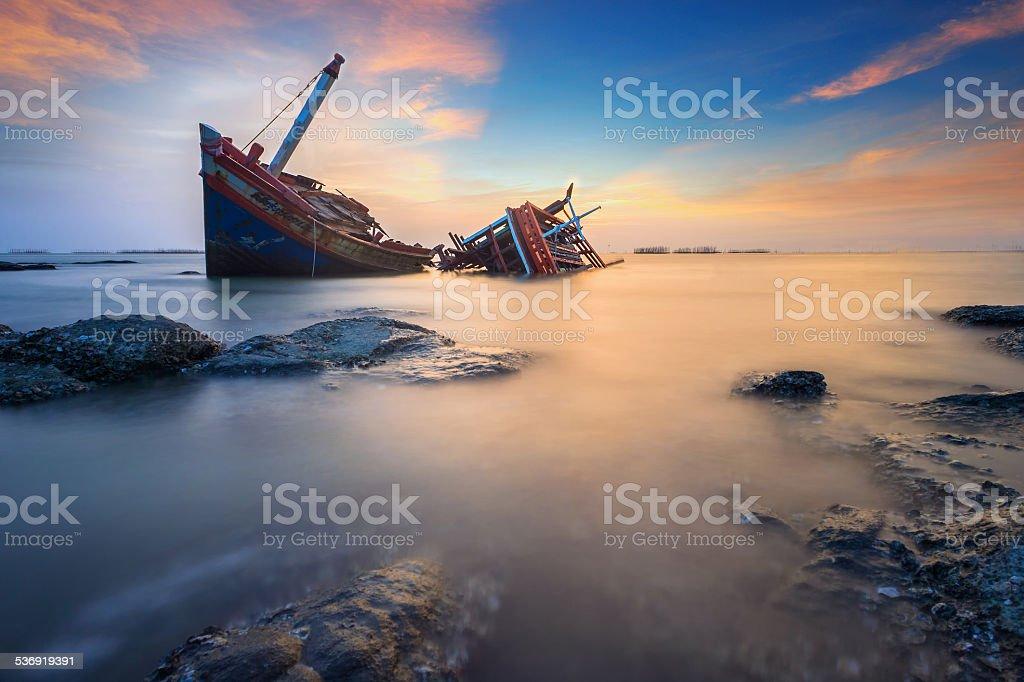 Broken ship in the sea stock photo