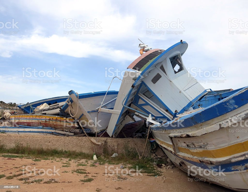 broken shipwrecks after the disembarkation of refugees stock photo