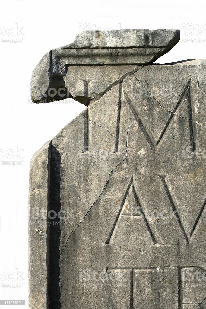 Broken stone with latin letters royalty-free stock photo