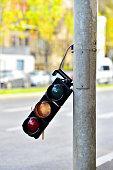 Broken traffic lights pole