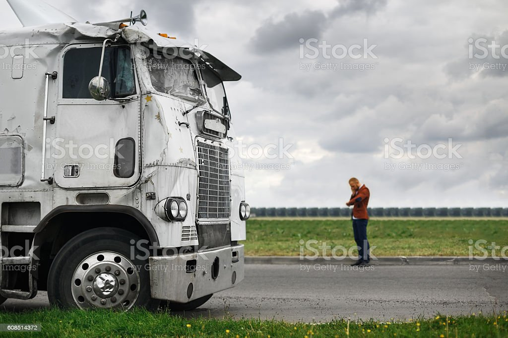 broken truck after the accident in foreground stock photo