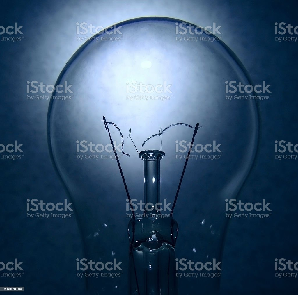 Broken tungsten filament inside electric bulb detailed stock photo