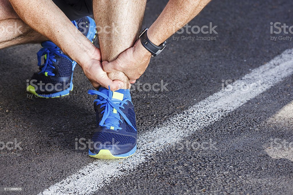 Broken twisted ankle - running sport injury. stock photo