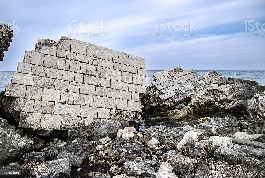 Broken wall on the beach royalty-free stock photo