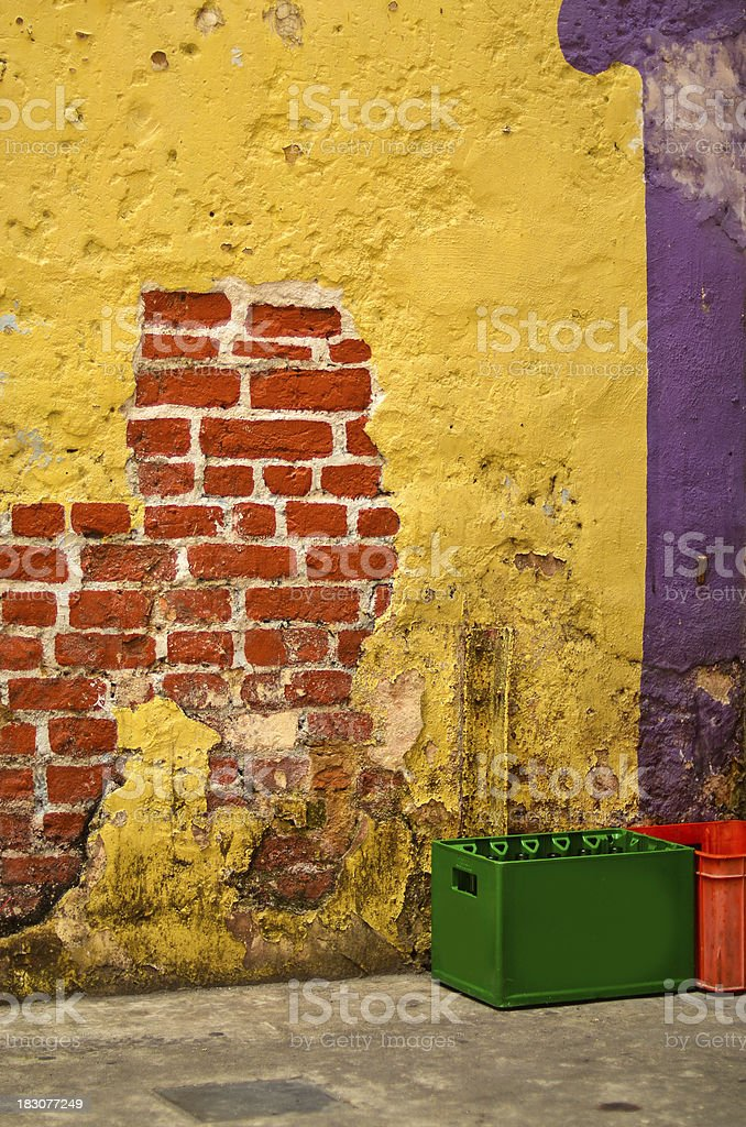Broken wall with beer crates adjacent. royalty-free stock photo