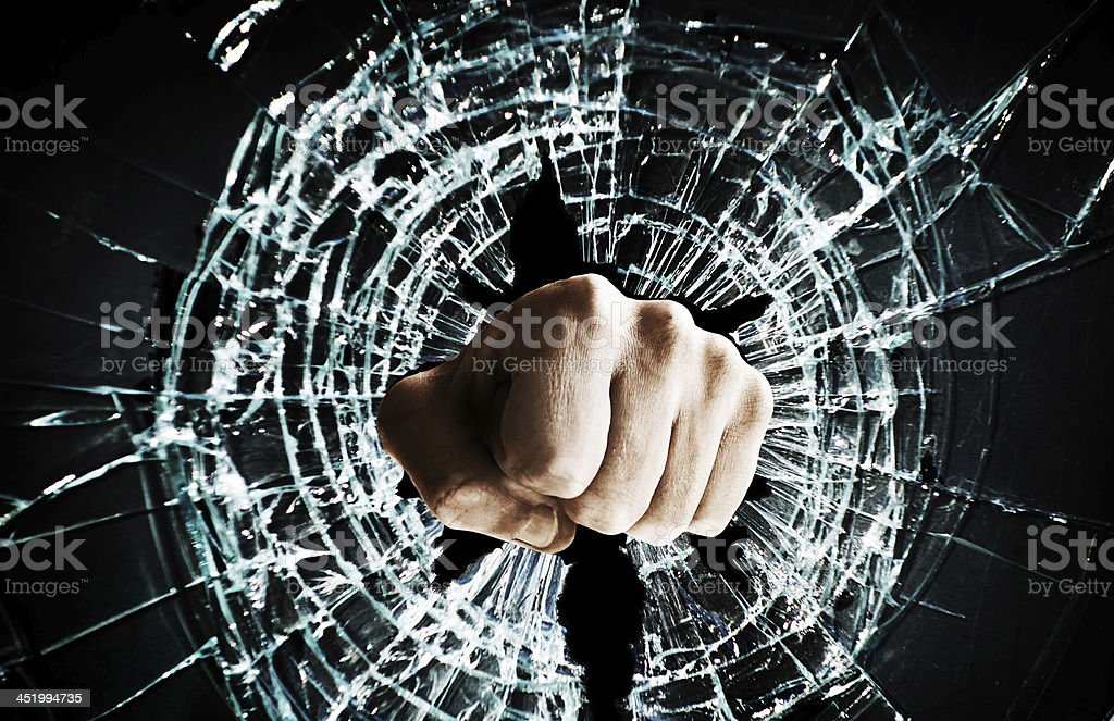broken window fist stock photo